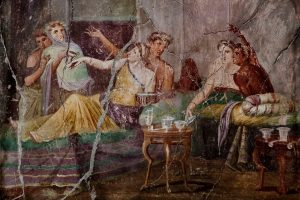 Roman fresco with banquet scene inside the House of Chaste Lovers in Pompeii